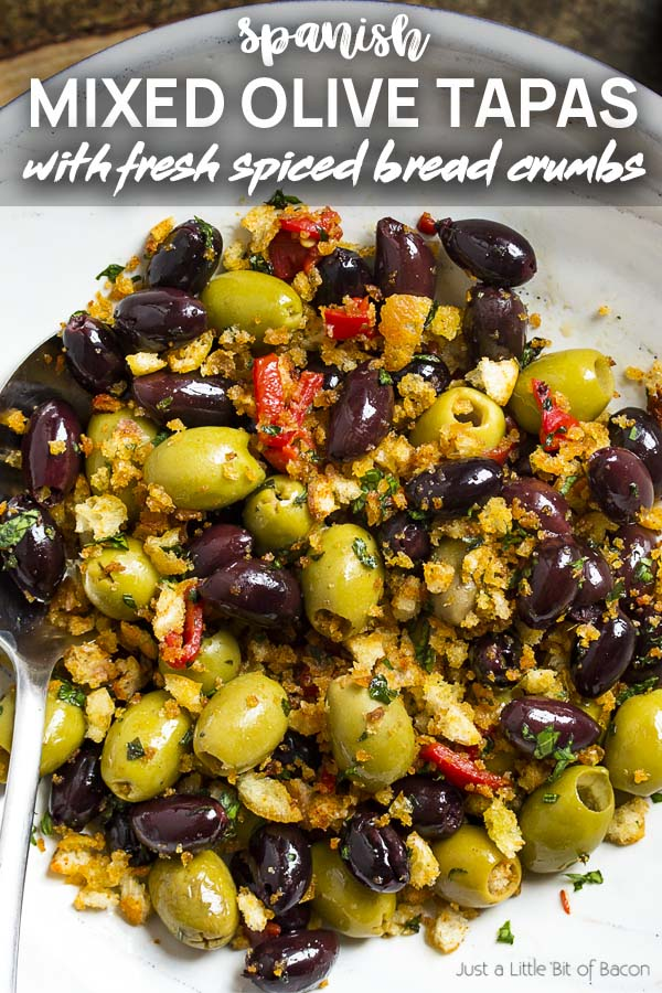 Recipe in a wide serving bowl with text overlay - Mixed Olive Tapas.