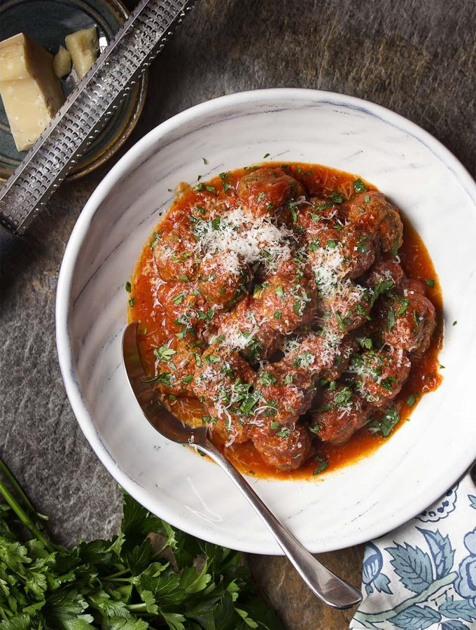 Learn how to make classic homemade meatballs! For the BEST authentic Italian meatballs and sauce mix together ground beef with fresh bread crumbs, parmesan, and spices then then pan fry and braise until tender. | justalittlebitofbacon.com #italianrecipes #italianfood #meatballs #beefrecipes #beef