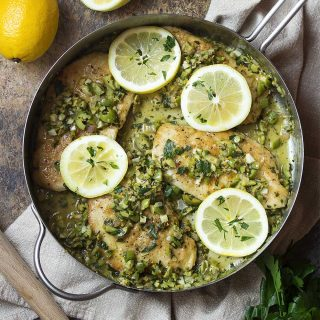 You'll love this simple Italian recipe for chicken with green olives! Flour coated chicken breast is pan fried and then served with a gremolata sauce made from orange and lemon zest, green olives, and chopped parsley. | justalittlebitofbacon.com #italianrecipes #chickenrecipes #chickenbreast #easydinner #italian #chicken