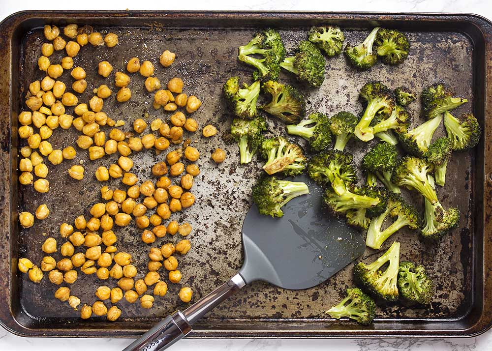 A sheet pan of roasted chickpeas and roasted broccoli.