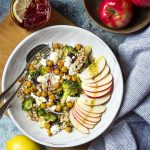 Greek farro salad has all the Mediterranean flavors you love along with healthy grains, roasted broccoli, and chickpeas for satisfying vegetarian winter meal. Serve warm or at room temperature. | justalittlebitofbacon.com #greekrecipes #mediterraneanrecipes #greeksalad #mediterraneansalads #farrorecipes #grainsalads #greek