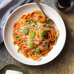 For an authentic Italian dinner, try my pasta al pomodoro! Spaghetti is tossed with a simple and delicious San Marzano tomato sauce and topped with basil and Parmesan in this easy recipe. | justalittlebitofbacon.com #italianrecipes #pastarecipes #easydinner #italian #spaghetti #pasta #tomatosauce