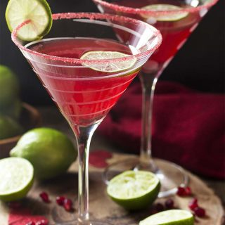 For the perfect holiday drink, try my vodka pomegranate martini cocktail! This easy recipe is well balanced, not too sweet, and simple to make. Great for Christmas, Valentine's Day, or any day you want a little something.   justalittlebitofbacon.com #cocktails #drinks #cocktailrecipes #drinkrecipes #pomegranate #martini #martinirecipes