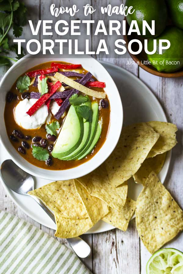 Soup in white bowl with chips and text overlay - Vegetarian Tortilla Soup.