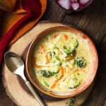 You'll love this easy creamy broccoli cheddar soup! This quick and flexible dinner uses evaporated milk, plenty of cheese, and shredded carrots for a satisfying meal. | justalittlebitofbacon.com #souprecipes #broccolirecipes #soup #broccoli #evaporatedmilk