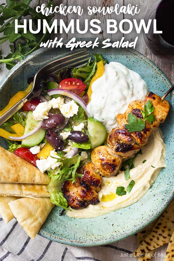 Chicken souvlaki in a salad with text overlay - Hummus Bowl.
