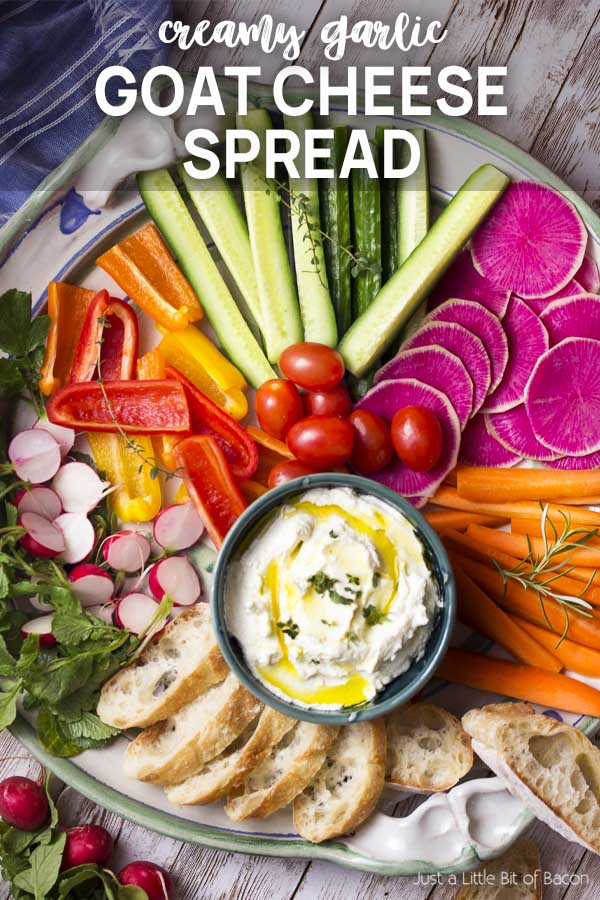 Recipe in a bowl on a platter of colorful crudites with text overlay - Goat Cheese Spread.