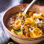 Get dinner on the table in 30 minutes with my Italian sausage tortellini soup! It's a snap to make this easy stovetop meal. Perfect for weeknights and family pleasing. | justalittlebitofbacon.com #italianrecipes #souprecipes #pastarecipes #italian #italianfood #tortellini #soup