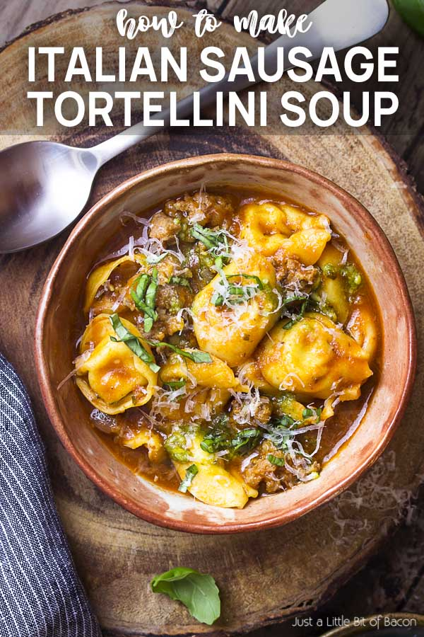 Recipe in a bowl with spoon and text overlay - Italian Sausage Tortellini Soup.
