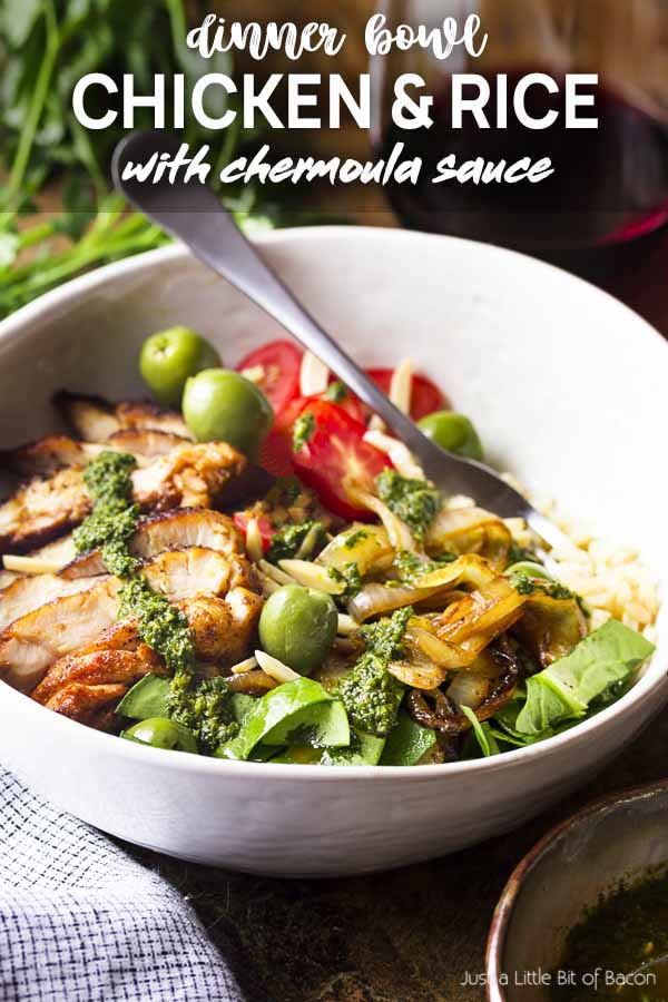Grilled chicken, rice, and vegetables in a bowl with text overlay - Chicken and Rice.