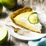 For a classic summertime treat make the best homemade key lime pie! Crunchy sweet graham cracker crust, creamy tart filling of condensed milk and lime, and a dollop of whipped cream on top. | justalittlebitofbacon.com #dessertrecipes #pierecipes #pie #dessert #keylimepie