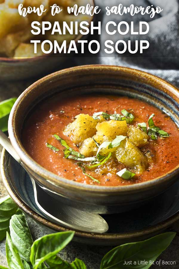 A bowl of tomato soup and croutons with text overlay - Spanish Cold Tomato Soup.