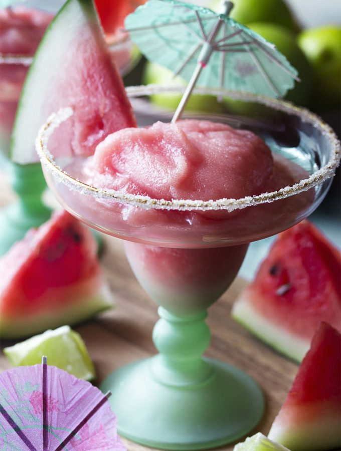 Learn how to make homemade frozen watermelon margaritas! This easy recipe starts with fresh fruit and can be whipped up in minutes with just a little prep work. | justalittlebitofbacon.com #margaritas #cocktailrecipes #drinkrecipes #summerrecipes #watermelon