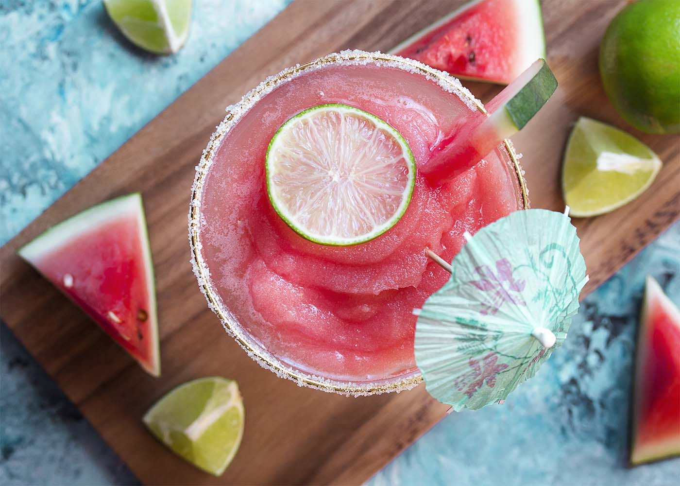 Top view of a sugar rimmed margarita glass filled with frozen watermelon cocktail.