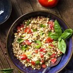 For a fresh and healthy summer side, you'll love this cold farro, corn and tomato salad! It's simple to make, full of whole grains, and perfect for picnics and bbqs. | justalittlebitofbacon.com #summerrecipes #saladrecipes #salads #corn #farro #wholegrains