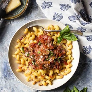 You'll love my easy and quick Italian meat sauce! This homemade recipe featuring canned tomatoes and ground beef is perfect over spaghetti, pasta, or zoodles and is a great weeknight dinner. | justalittlebitofbacon.com #tomatosauce #italianrecipes #meatsauce #italianfood