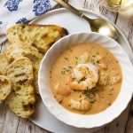 Learn how to make the best creamy shrimp bisque! This easy French recipe features a rich stock using the shells, tomato paste, and a bit of bourbon to create a wonderfully complex soup. | justalittlebitofbacon.com #shrimprecipes #seafoodrecipes #souprecipes #frenchfood #shrimp #bisque #french