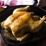 Small holiday gathering or Sunday dinner? Try my easy cast iron roast chicken! Less than an hour in oven and you'll have browned skin and juicy meat. Try my recipe for easy cast iron roast chicken! Less than an hour in oven and you'll have browned skin and juicy meat with no fuss. Perfect for Thanksgiving, Christmas, Easter, and more! | justalittlebitofbacon.com #roastchicken #castiron #easydinner #thanksgiving #christmas #easter #sundaydinner