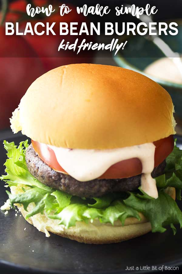 Close up of a burger on a bun with toppings and text overlay - Black Bean Burgers.