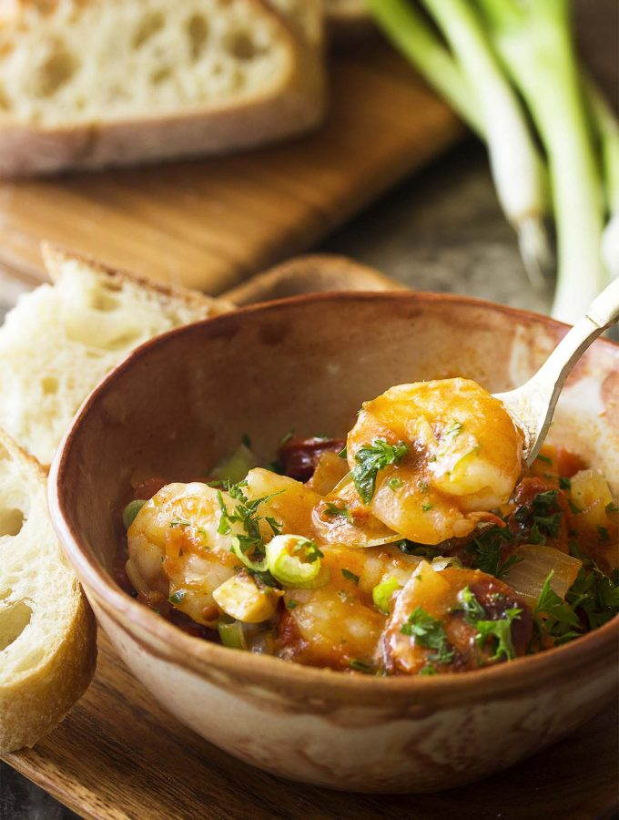 You'll love this simple, Spanish-inspired stew with shrimp and chorizo! It's quick to make and has TONS of flavor. Perfect for a weeknight dinner. | justalittlebitofbacon.com #spanishfood #dinnerecipes #stew #comfortfood