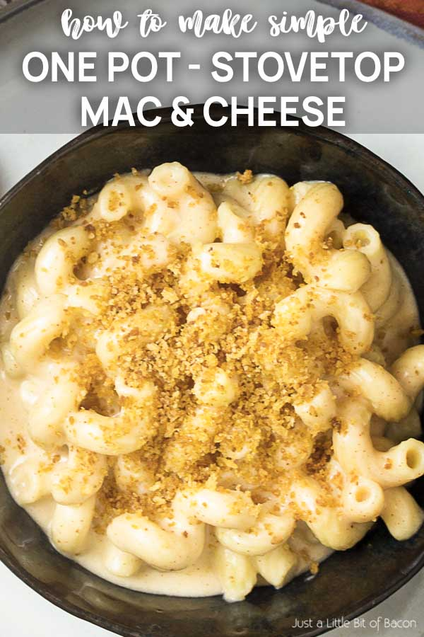 Close of up a bowl of creamy pasta with text overlay - One Pot Stovetop Mac and Cheese.