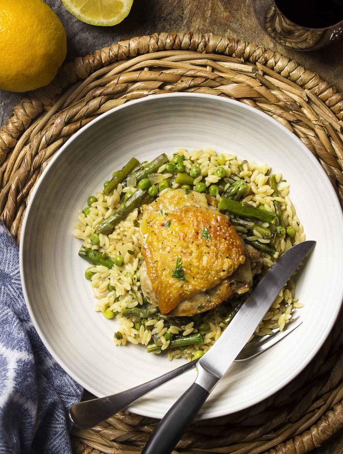 Use only a skillet in my one pot chicken and orzo dinner! Juicy thighs, pasta, and plenty of vegetables in this easy, weeknight meal. | justalittlebitofbacon.com
