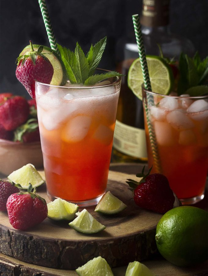 For a summertime twist on a classic cocktail try my strawberry mojitos! Lime, mint, rum, fresh fruit, and sparkling water make an easy drink perfect for hot weather. | justalittlebitofbacon.com