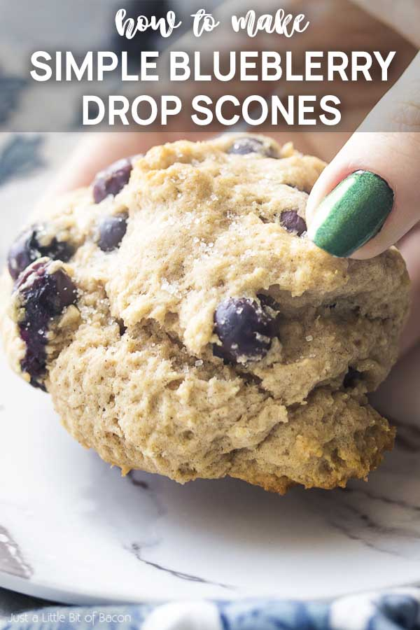 Hand holding a scone with text overlay - Simple Blueberry Drop Scones.